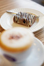 Morning cake close up coffe cup with capuchino and in street cafe Royalty Free Stock Photo
