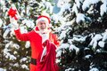 The morning before Christmas. Santa Claus in red costume walk in winter forest. Wish you merry Christmas. Father Royalty Free Stock Photo