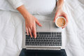 Morning coffee with laptop. Internet addiction. Royalty Free Stock Photo