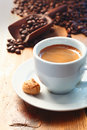 Morning cup of frothy espresso coffee Royalty Free Stock Photo