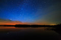 Morning dawn on  starry background sky reflected in the water Royalty Free Stock Photo