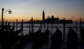 Morning dawn in venice black silhouettes of gondolas on sky and san giorgio maggiore background italy Stock Images