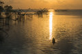 Morning fishery commercial use big fishnet in lake Stock Photography