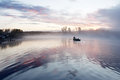 Morning fog boat lake Stock Image