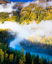 Morning fog over Moon Bay, Kanas, Xinjiang China Stock Photos