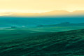 Morning fog view on farmland in tuscany italy at valley d orcia lomo toned Stock Photography
