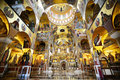 Morning in gold lighted church the interior of the beautiful resurrection of christ podgorica montenegro the cathedral has Royalty Free Stock Photo