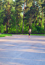 Morning jog in wood. Royalty Free Stock Photo