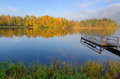 Morning lake reflections idyllic landscape in autumn season Stock Images