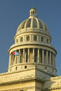 Morning light on the Capitolio and Cuban Flag, the Cuban capitol building and dome in Havana, Cuba