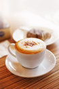 Morning light on coffee close up coffe cup with capuchino and cake in street cafe Stock Image
