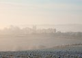 Morning mist cotswolds winter looking towards chipping campden through the gloucestershire england Stock Photos