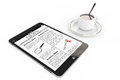 Morning news concept modern tablet pc and cup of coffee on a white background Stock Photography