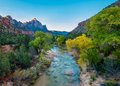 Morning rays virgin river watchman peak zion national park ut illuminate fall colors along the and utah Stock Images