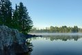 Morning Reflections on a Foggy Wilderness Lake Royalty Free Stock Photo