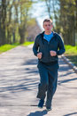 Morning runs man leads a healthy lifestyle Stock Photo