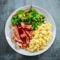 Morning Scrambled egg, bacon breakfast on white plate