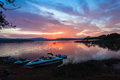 Morning sky cloud colors boats dam dawn water landscape on local with ski on shoreline and distant bass fishing boat Royalty Free Stock Image