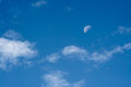 Morning sky with the half moon and clouds Stock Image