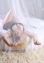Morning stout good young woman in black lingerie on white bed with canopy Royalty Free Stock Photography