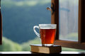 Morning tea cup of and book on window sill Royalty Free Stock Image