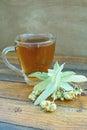Morning tea natural linden against wooden background Stock Images