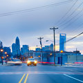 Morning traffic on a street charlotte nc skyline early in the Royalty Free Stock Image