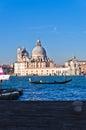 Morning in Venice, gondolas, Grand Canal and Santa Maria church Royalty Free Stock Photo