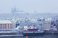 Morning view from charles bridge on snow prague castle Stock Images