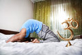 Morning yoga on the bed Royalty Free Stock Photo