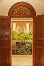 Moroccan balcony entrance with carved wooden doors and fanlight ornately hand like the ones seen here opening onto a are the Royalty Free Stock Images