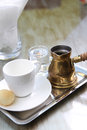 Moroccan coffee or arabic coffee turkish served with sugar syrup Stock Photos