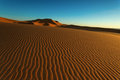 Moroccan desert landscape with blue sky. Dunes background. Royalty Free Stock Photo