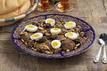 Moroccan meat plums and eggs festivity dish with almonds Royalty Free Stock Photography