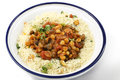 Moroccan style chickpeas and mushrooms or garbanzo beans quartered button cooked in a spicy tomato onion sauce served with Stock Images