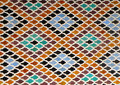 Moroccan Style Diamond-shaped pattern Bright Blue Orange Brown Color Tiled Wall in Fez, Morocco Royalty Free Stock Photo