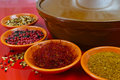 Moroccan tahine with four bowls with spices on red background Royalty Free Stock Photo