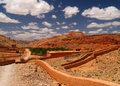 Morocco old village in red mountains clouds and sky Royalty Free Stock Photography