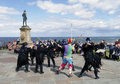 Morris dancers at whitby north yorkshire uk circa august traditional perform in front of tourists during s folk festival Stock Photos