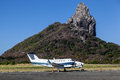 Morro do pico fernando de noronha airport the rock and the with a small airplane in island pernambuco brazil Stock Photography