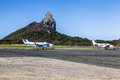 Morro do pico fernando de noronha airport the rock and the with two small airplanes in island pernambuco brazil Royalty Free Stock Images
