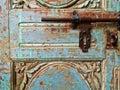 Morroccan vintage metal lock key on blue old door Royalty Free Stock Photo