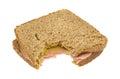 Mortadella sandwich on wheat with mustard bitten Royalty Free Stock Photo
