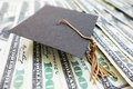 Mortar board cash closeup of a mini graduation cap on Royalty Free Stock Photos
