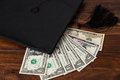 Mortar Board and dollar Royalty Free Stock Photo