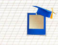 Mortar board or graduation cap with blue slide on the background notebook sheet Stock Photos