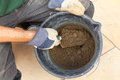 Mortar mixing sand cement and water for a dry mix Royalty Free Stock Photography