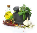 Mortar and pestle with fresh herbs black stone Stock Image