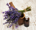 Mortar and pestle with lavender on a wooden background Royalty Free Stock Images