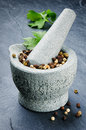 Mortar and pestle with pepper mix Royalty Free Stock Photo